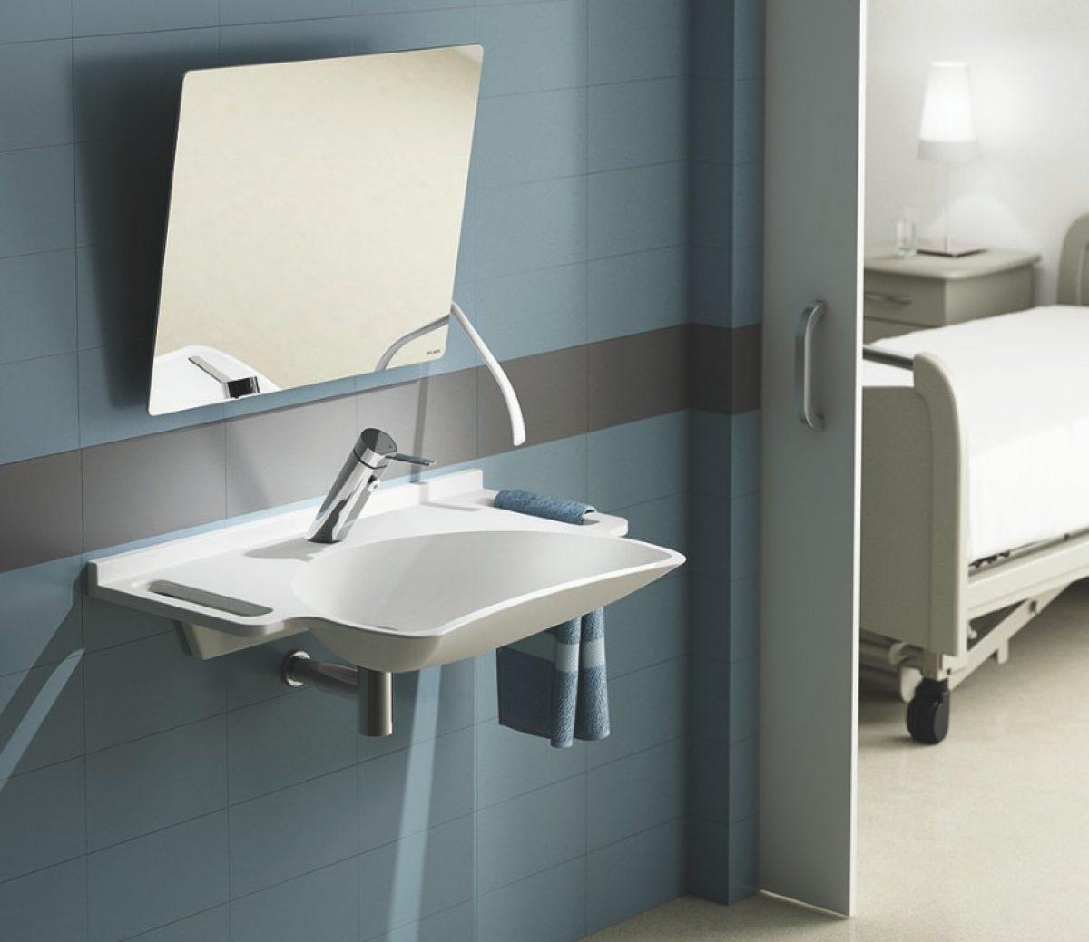 Wastafel met handgrepen en kantelbare spiegel van delabie for Spiegel voor in de wc